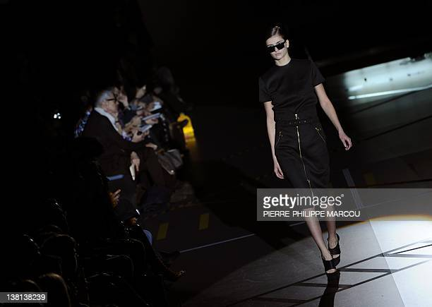 A model displays an outfit by Spanish designer David Delfin during the presentation of the Autumn/Winter collections of the MercedesBenz Fashion Week...
