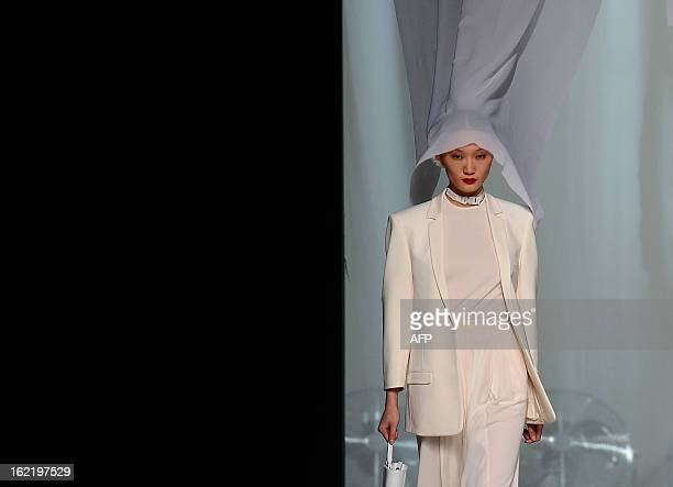 A model displays an outfit by Spanish designer David Delfin of the Autumn/Winter 20132014 collection during the Mercedes Benz Madrid Fashion Week in...