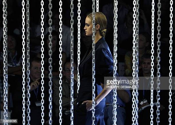 A model displays an outfit by Spanish designer David Delfin part of his Spring/Summer 2008 collection show at Madrid fashion week 19 September 2007...