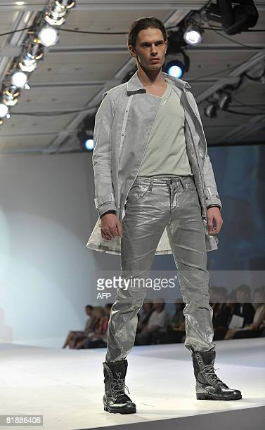 """Model displays an outfit from """"New Organism"""" by designer Ronny Ng during the """"Hong Kong Fashion Collection Award"""" at the Hong Kong Fashion Week..."""