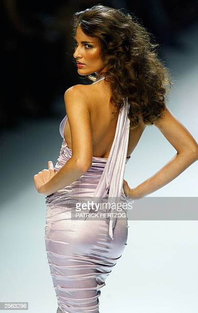 Model displays an outfit of Italian designer Donatella Versace during the show of the Gianni Versace collection 04 October 2003, during the...