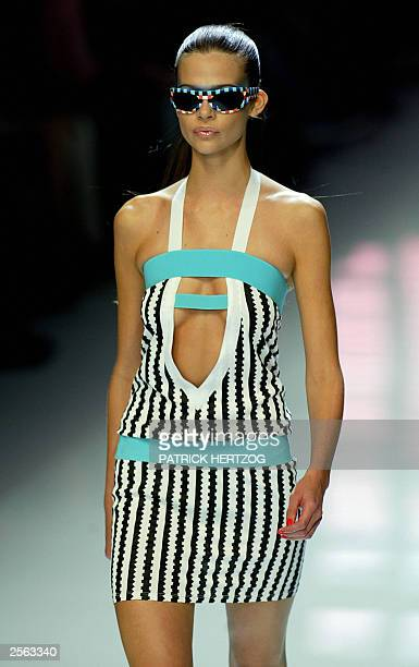 A model displays an outfit of Italian designer Donatella Versace during the show of the Versus youth collection of Gianni Versace 04 October 2003...