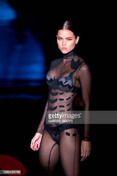 A model displays an outfit of Spanish designer Andres Sarda's Autumn/Winter 2019 collection during the Madrid's Mercedes Benz Fashion Week on January...