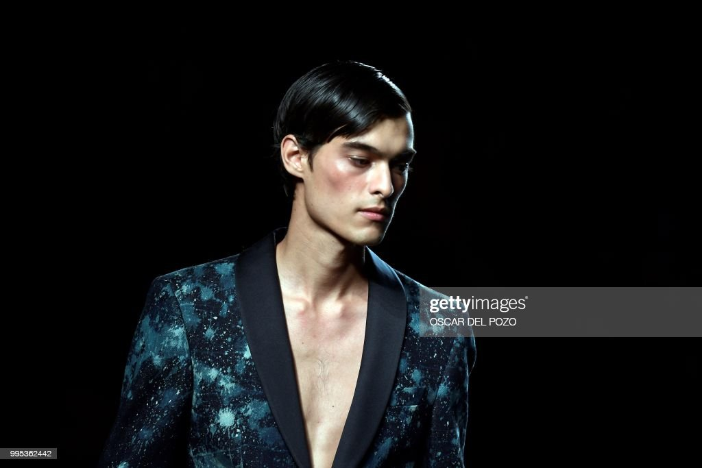 TOPSHOT - A model displays an outfit of Spanish designer Garcia Madrid Spring/Summer 2019 collection during the Madrid's Mercedes Benz Fashion Week on July 10, 2018.
