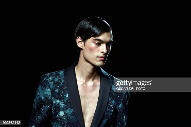 TOPSHOT A model displays an outfit of Spanish designer Garcia Madrid Spring/Summer 2019 collection during the Madrid's Mercedes Benz Fashion Week on...