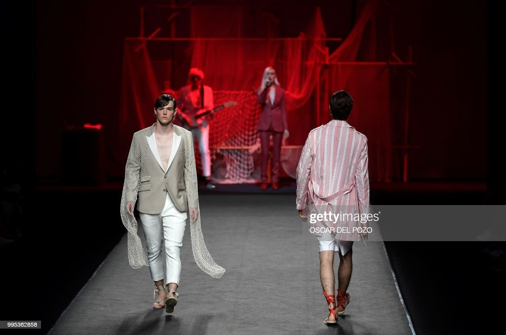 A model displays an outfit of Spanish designer Garcia Madrid Spring/Summer 2019 collection during the Madrid's Mercedes Benz Fashion Week on July 10, 2018.