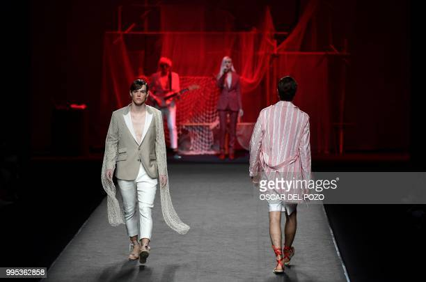 A model displays an outfit of Spanish designer Garcia Madrid Spring/Summer 2019 collection during the Madrid's Mercedes Benz Fashion Week on July 10...