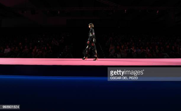 A model displays an outfit of Spanish designer Maria Escote Spring/Summer 2019 collection during the Madrid's Mercedes Benz Fashion Week on July 08...