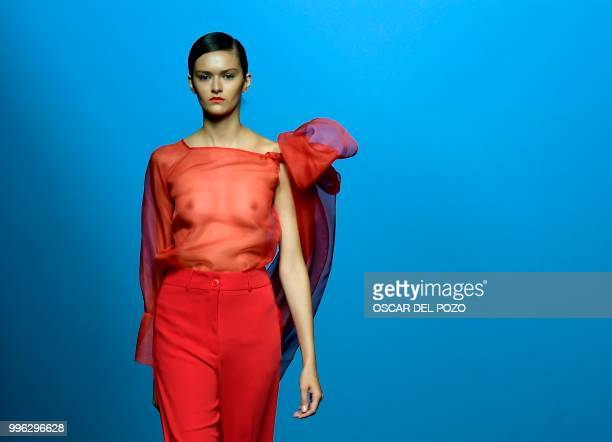 A model displays an outfit of Spanish designer Menchen Tomas Spring/Summer 2019 collection during the Madrid's Mercedes Benz Fashion Week on July 11...