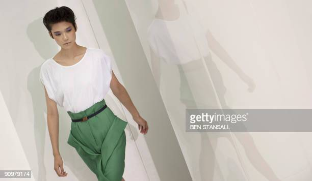 A model displays an outfits by designer Nicole Farhi during Spring/Summer 2010 collection show on the third day of the London Fashion Week in central...