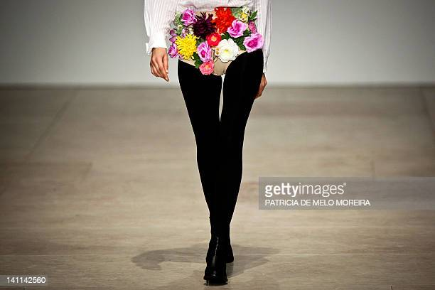 A model displays Autum/Winter 2013 creations by Portuguese fashion designer Alexandra Moura during the 38th Edition of Moda Lisboa at Patio da Gale...