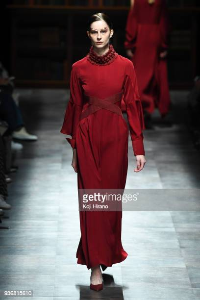 A model displays clothes by the designer Mori Hanae on the runway during the Amazon Fashion Week TOKYO 2018 A/W on March 23 2018 in Tokyo Japan