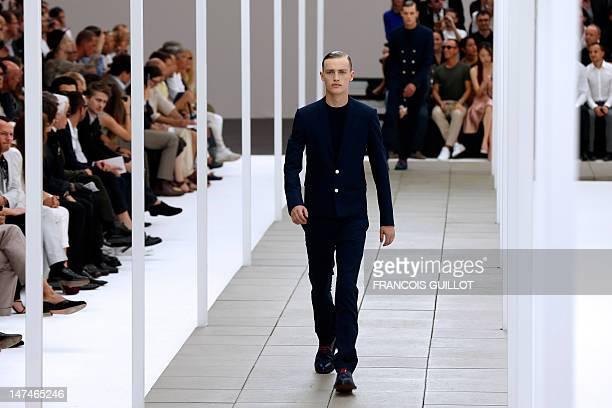 A model displays creations by Belgian designer Kris Van Assche for the label Dior during the men's springsummer 2013 fashion collection show on June...