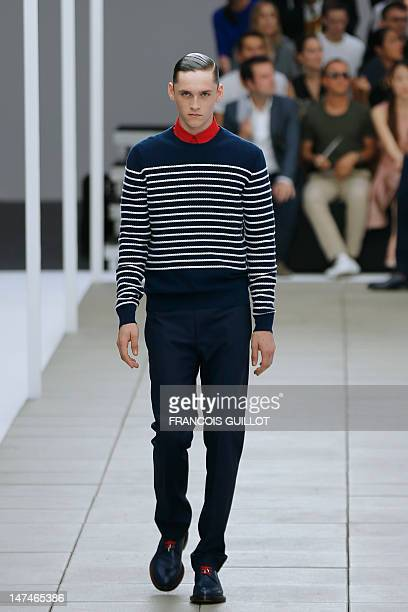 Model displays creations by Belgian designer Kris Van Assche for the label Dior during the men's spring-summer 2013 fashion collection show on June...