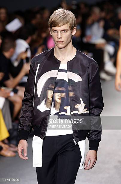 Model displays creations by Italian fashion designer Ricardo Tisci for Givenchy during the men's spring-summer 2013 fashion collection show on June...