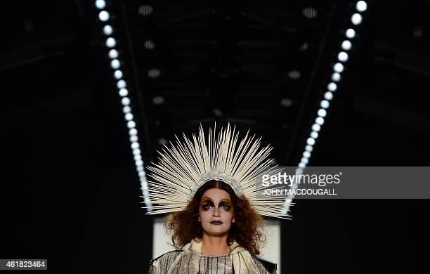 A model displays fashion by German designer Rebekka Ruetz from the Autumn/Winter 2015 collection during the Berlin Fahion Week on January 20 2015...