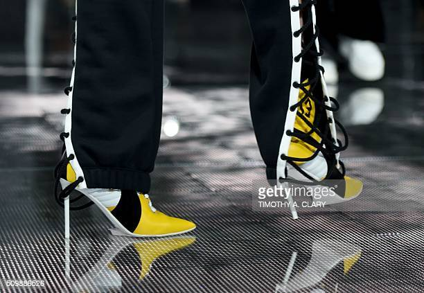 A model displays fashions during the Fenty PUMA by Rihanna show during the Fall 2016 New York Fashion Week in New York on February 12 2016 / AFP /...