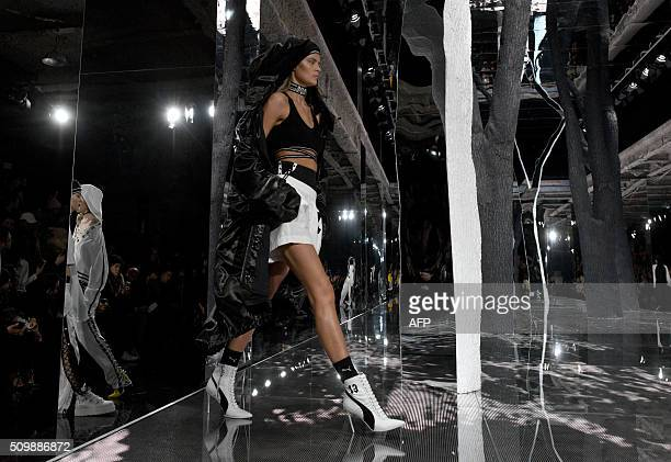 A model displays fashions during the Fenty PUMA by Rihanna show during the Fall 2016 New York Fashion Week in New York on February 12 2016 / AFP