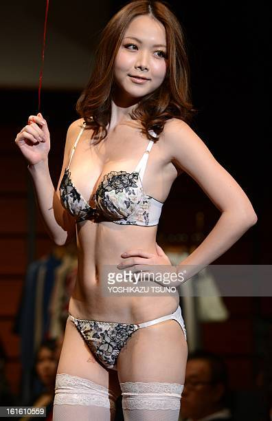 A model displays Japanese apparel maker Sanai' latest lingerie from their 2013 collection in Tokyo on February 13 2013 AFP PHOTO / Yoshikazu TSUNO
