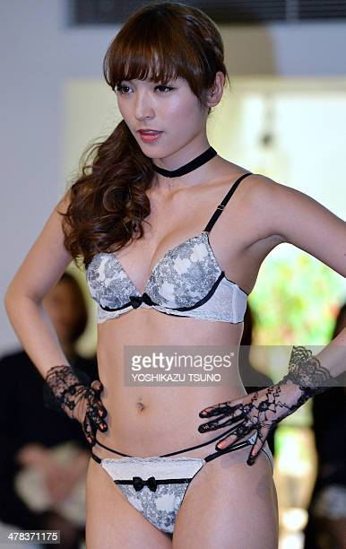 A model displays lingerie from Japanese apparel maker Sanai' during their 2014 collection in Tokyo on March 13 2014 AFP PHOTO / Yoshikazu TSUNO