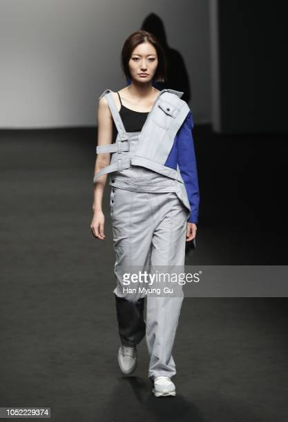 A model displays the creation by DOZOH on runway during the HERA Seoul Fashion Week S/S 2019 at DDP on October 16 2018 in Seoul South Korea