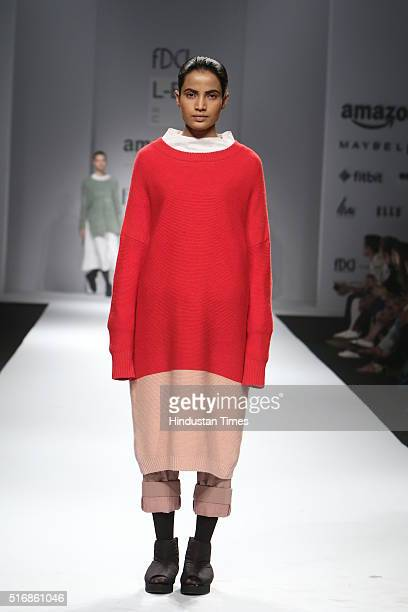 A model displays the creation of Designer Label Love Birds by Designer duo Amrita Khanna and Gursi Singh during the Day4 of Amazon India fashion Week...