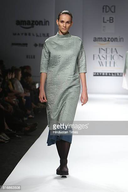 A model displays the creation of Designer Label Love Birds by Designers duo Amrita Khanna and Gursi Singh during the Day4 of Amazon India Fashion...