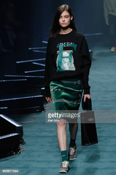 A model displays the design by FREIKNOCK on the runway during the Amazon Fashion Week TOKYO 2018 A/W at Shibuya Hikarie on March 19 2018 in Tokyo...