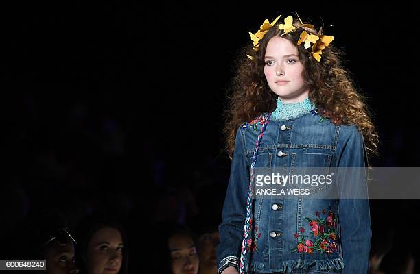 A model displays the fashion of Desigual during New York Fashion Week on September 8 2016 / AFP / ANGELA WEISS