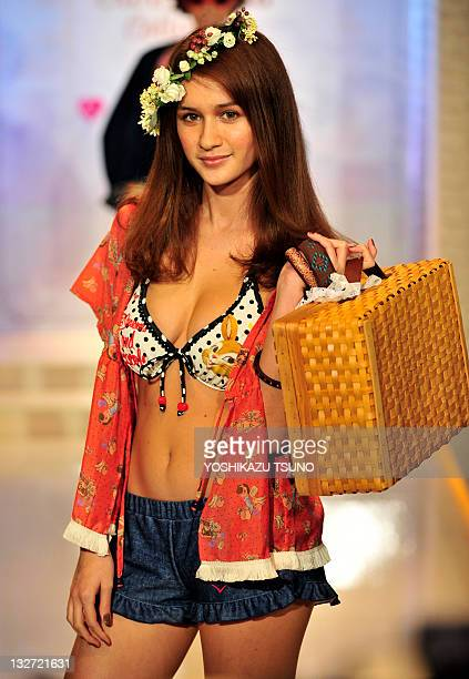 Model displays the latest swimwear during Japanese apparel maker San-ai's 2012 collection in Tokyo on November 14, 2011. Japanese apparel maker...