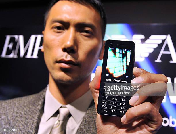 A model displays the new 'Night Effect' SoftBank 830C Emporio Armani mobile phone model produced by South Korean electronics giant Samsung during a...