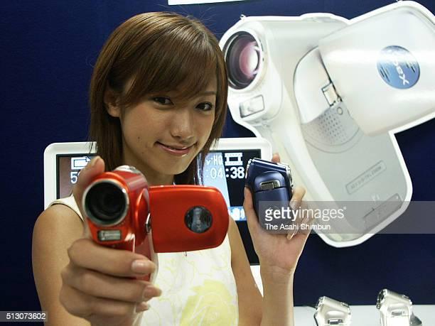 A model displays the Sanyo Electrics new digital camera recorder Xacti on August 23 2004 in Osaka Japan