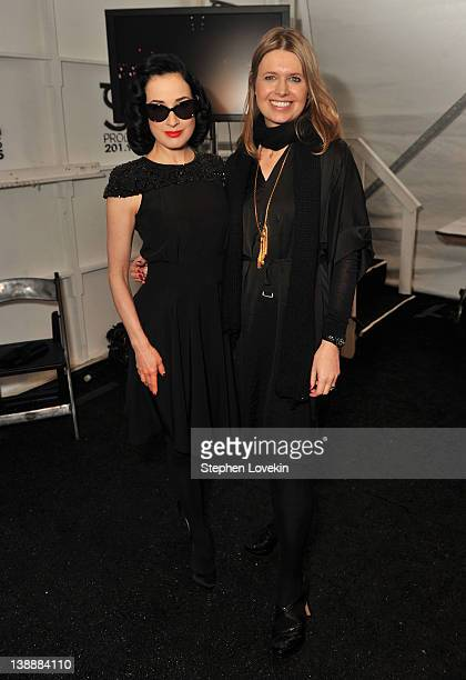 Model Dita Von Teese and designer Jenny Packham pose backstage at the Jenny Packham Fall 2012 fashion show during MercedesBenz Fashion Week at The...