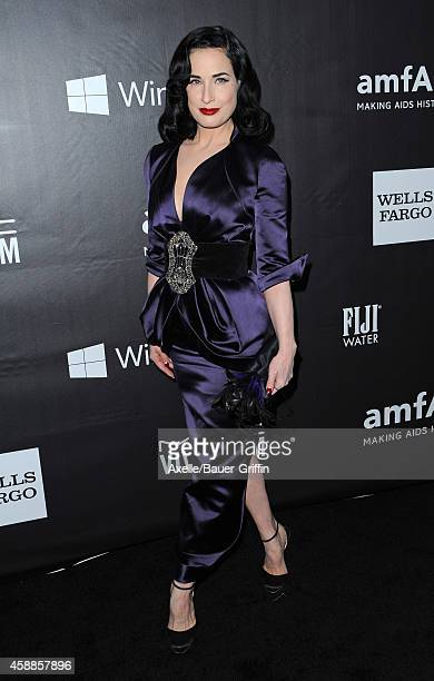Model Dita Von Teese arrives at the 2014 amfAR LA Inspiration Gala at Milk Studios on October 29 2014 in Hollywood California