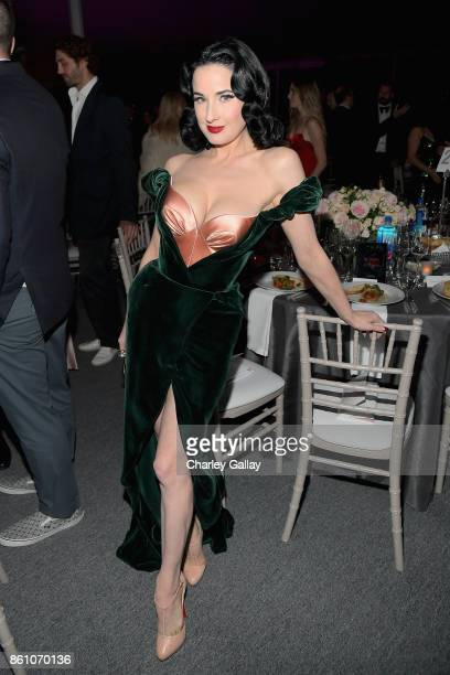 Model Dita Von Teese attends the amfAR Gala Los Angeles 2017 at Ron Burkle's Green Acres Estate on October 13 2017 in Beverly Hills California