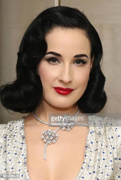 Model Dita Von Teese attends the unveiling of Van Cleef Arpels redesigned New York 5th Avenue Flagship Maison at Van Cleef Arpels on December 10 2013...