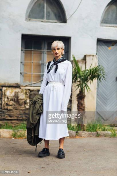 Model DJ Sasha Panika wears a white cotton longsleeve shirt tucked into a white cotton skirt and a blue bandana around her neck on Day 3 of...