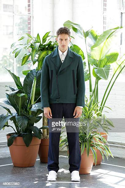 Model Dmitry Brylev of Russia poses at the Carlos Campos Spring/Summer 2016 Presentation during New York Fashion Week: Men's S/S 2016 at Industria...
