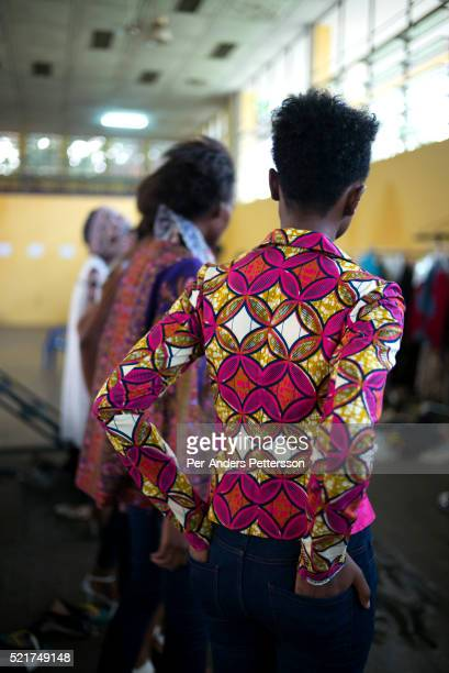 Model do fittings for the Bombix by Rose Bombo label a few days before Kinshasa Fashion Week on July 23 at the boxing gym at Shark club in Kinshasa...
