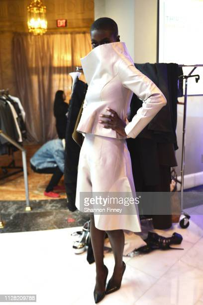 A model does a final fitting of an ensemble by the designer Shafei Han backstage at the District of Fashion Fall/Winter 2019 Runway Show on February...
