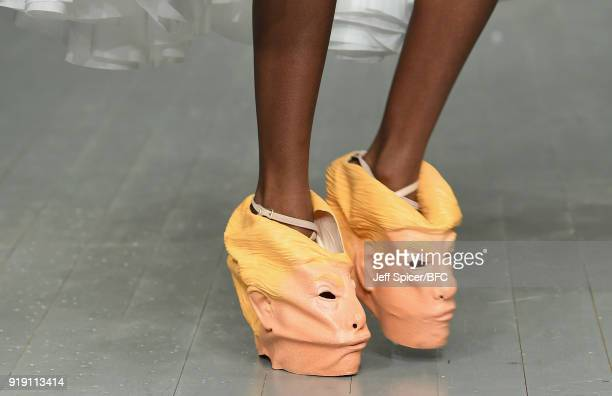 A model Donald Trump shoe detail walks the runway at the Central Saint Martins MA show during London Fashion Week February 2018 at BFC Show Space on...
