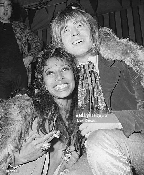 Model Donyale Luna and Brian Jones of The Rolling Stones at the recording of the television show Rolling Stones Rock'n'Roll Circus Show