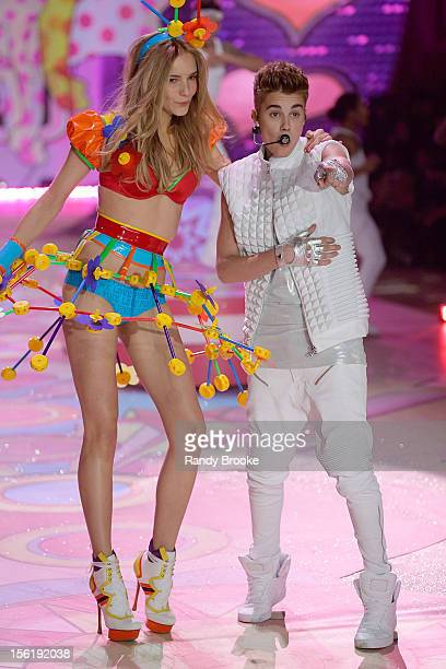 Model Dorothea Barth Jorgensen with Justin Bieber as he performs during the 2012 Victoria's Secret Fashion Show at the Lexington Avenue Armory on...