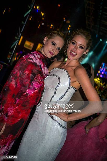 Model Doutzen Kroes and Aime Mullins photographed at the amfAR Cinema Against AIDS gala, for Paris Match on May 24 in Cap d'Antibes, France.