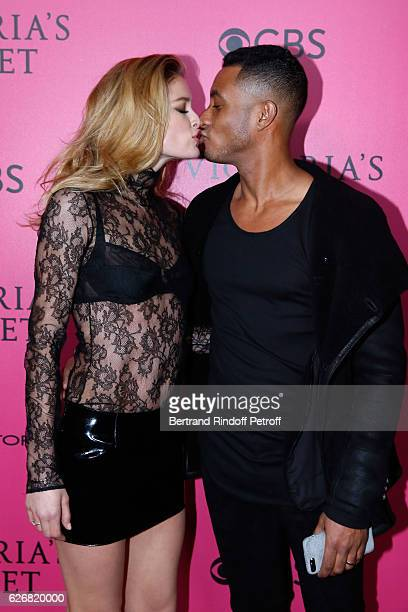 Model Doutzen Kroes and her husband DJ Sunnery James attend the 2016 Victoria's Secret Fashion Show Held at Grand Palais on November 30 2016 in Paris...