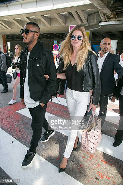Model Doutzen Kroes and husband Sunnery James arrive at Nice airport ahead the 68th annual Cannes Film Festival on May 12 2015 in Cannes France
