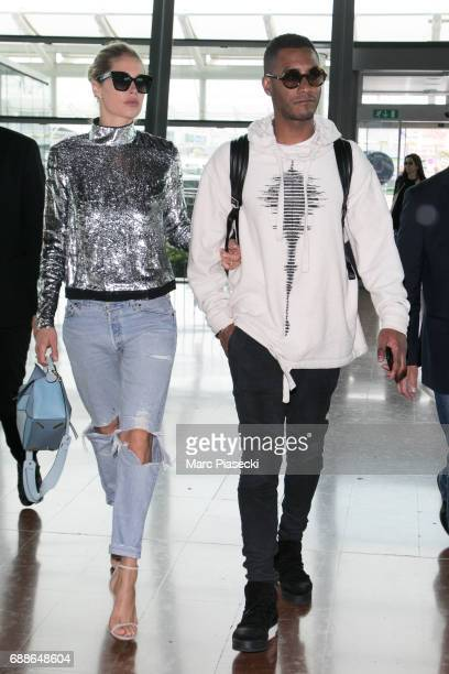 Model Doutzen Kroes and husband Sunnery James leave Nice airport during the 70th annual Cannes Film Festival at on May 26 2017 in Cannes France