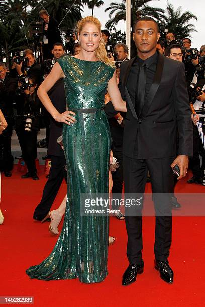 Model Doutzen Kroes and Sunnery James attend the 'Cosmopolis' premiere during the 65th Annual Cannes Film Festival at Palais des Festivals on May 25...