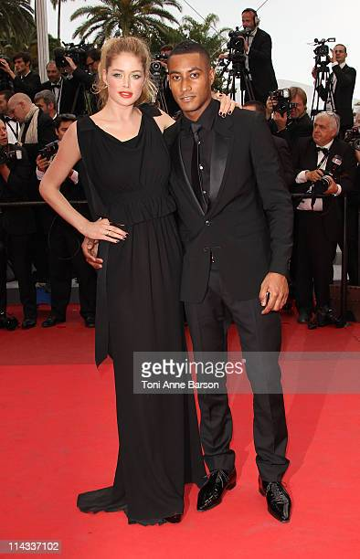 Model Doutzen Kroes and Sunnery James attends the 'La Conquete' Premiere during the 64th Annual Cannes Film Festival at the Palais des Festivals on...
