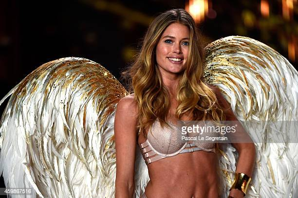 Model Doutzen Kroes walks the runway at the annual Victoria's Secret fashion show at Earls Court on December 2 2014 in London England